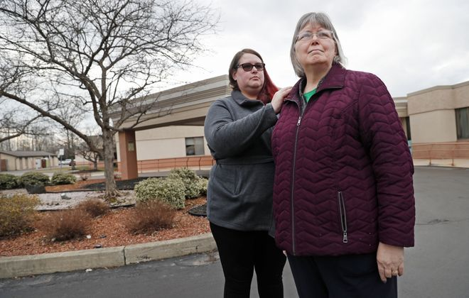 """Miriam Hanley, right, and her daughter Karoline Hanley, stand outside Northgate Health Care Facility on Tuesday, March 17, 2020. Miriam's husband, Elvin """"Bill"""" Hanley was in a hospice bed in the nursing home. Although Miriam expects her husband to die any day, the nursing home would not let his immediate family visit him because of a statewide COVID-19 precaution limiting visits at nursing homes. (Robert Kirkham/Buffalo News)"""