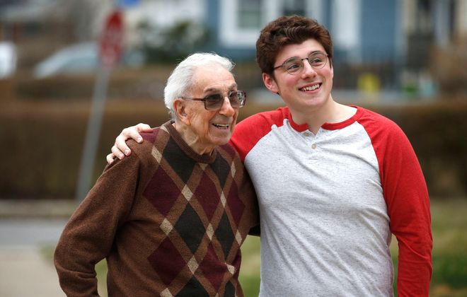 Paul Catalano, 98, with his grandson Dante Lasting, 20. Since Lasting's return from SUNY Fredonia, they have been living in the same house, where Lasting does what he can to help his grandfather while both men avoid outside contact as much as possible during this time of concern about Covid-19. (Robert Kirkham/Buffalo News)