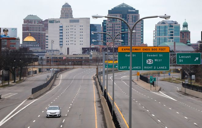 A car leaves downtown on out-bound Route 33 in Buffalo Thursday, March 19, 2020.       (Mark Mulville/Buffalo News)