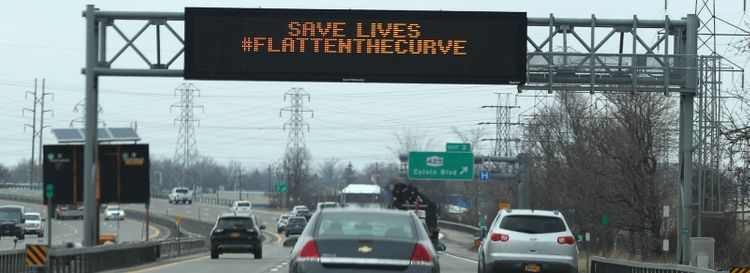 An alert sign on the 290 warns drivers of the danger of the COVID-19 virus. (James P. McCoy/News file photo)