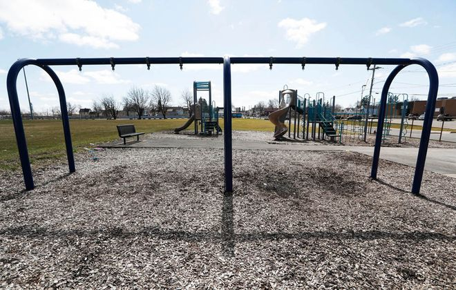All the swings were taken off the swing set at the park on Manhattan Avenue in Buffalo. All playgrounds were closed to try to  contain the spread of the  novel coronavirus. (Sharon Cantillon/Buffalo News)