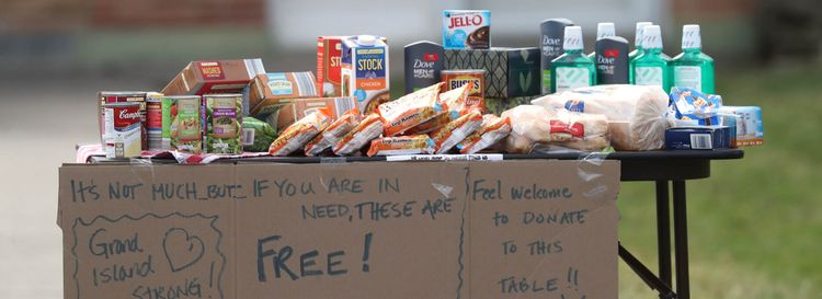 A table set up outside a Grand Island home. offering necessities to anyone in need, on March 21. (James P. McCoy/Buffalo News)