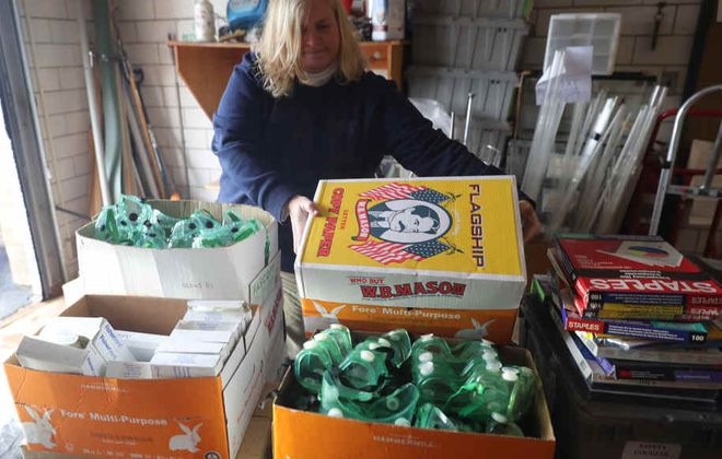 Tracy Spagnolo, director of Pupil Personnel Services for West Seneca Central School District, helps collect goggles, masks, transparencies from overhead projectors that could be used as shields, hand sanitizer and other equipment that might help health care workers. Monday, March 23, 2020. (John Hickey/Buffalo News)