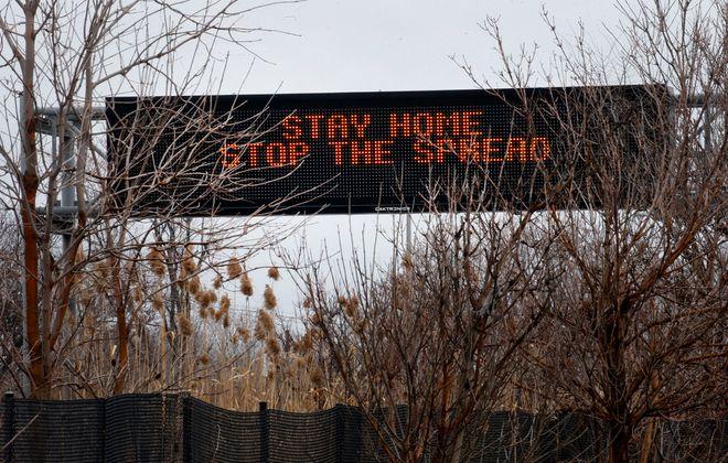 A sign along Route 33 in Buffalo on Monday, March 23, 2020. (Robert Kirkham/Buffalo News)