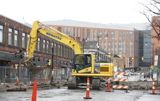 Tim King of Destro Brothers tears up a section of Allen Street in Buffalo with the excavator on Monday, March 23, 2020.  (Sharon Cantillon/Buffalo News)
