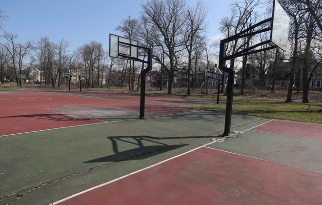 Basketball rims have been removed at courts in Delaware Park. (John Hickey/Buffalo News)