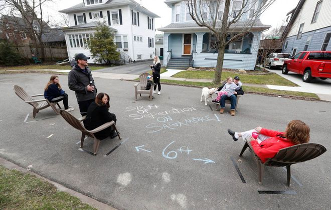 """Jeff Miers writes that some North Buffalo neighbors have used """"a little bit of ingenuity and a few pieces of chalk to create a 'Six Feet of Separation' party, for which strategically placed markings on the pavement ensure guests maintain the recommended distance from each other, while still being able to intermingle."""" (Sharon Cantillon/Buffalo News)"""
