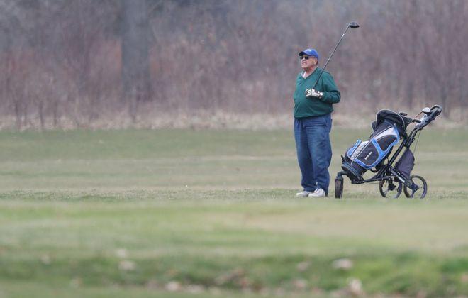 Mike Logue of Buffalo plays golf at Delaware Park. (James P. McCoy/Buffalo News)
