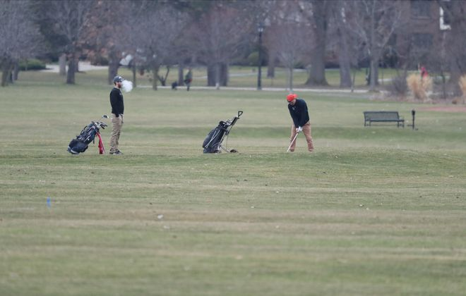 Golfers play a round at Delaware Park. (James P. McCoy/News file photo)
