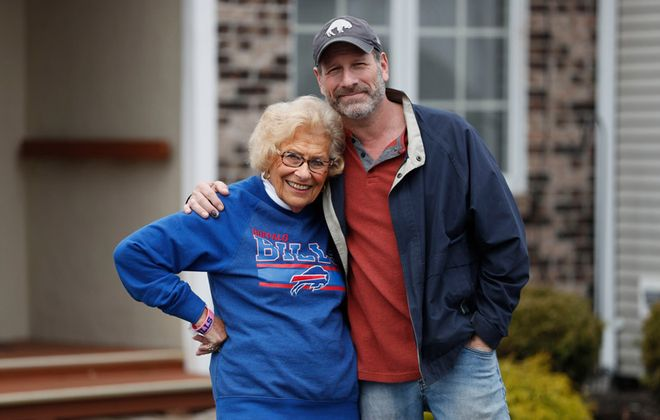 Comedian and radio personality Rob Lederman and his mother, Gerry Lederman, outside her home in Williamsville. (Sharon Cantillon/Buffalo News)