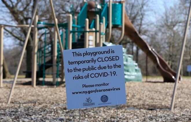 A closed playground sign placed in Delaware Park. (Harry Scull Jr./Buffalo News)