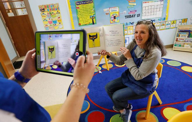 LE3 Academy's Mia Curry and other staffers create one of their daily distance learning videos for the kids, while the day care waits to reopen if enrollment increases. (Sharon Cantillon/Buffalo News)