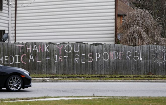 A sign thanking our medical professionals and first responders on a fence on Maple Road in Amherst. (Mark Mulville/Buffalo News)