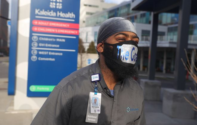 Rayshen Rockwell a dietary worker heads to work at Buffalo General Hospital in Buffalo, on Thursday, March 26, 2020, with a mask a friend made for him. (John Hickey/Buffalo News)