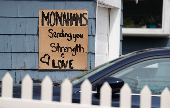 Walter Monahan, 74, of Kenmore, who died Wednesday, March 25, 2020, was the second Covid-19 patient to die in Erie County.  Neighbors put a cardboard sign of encouragement on their own garage that Monahan's wife, Valerie, and daughter, Kelly Frothingham, could see from their back door. (Sharon Cantillon/Buffalo News)