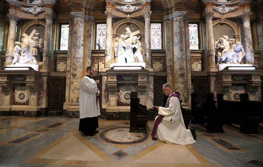 With Covid-19 closing churches, Holy Week rituals go virtual