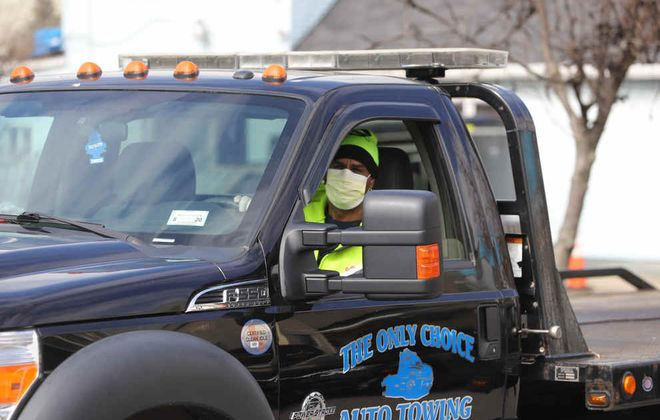 Tow truck driver Jose Deleon wears a mask at Fargo Street in Buffalo on March 27, 2020. (John Hickey/News file photo)