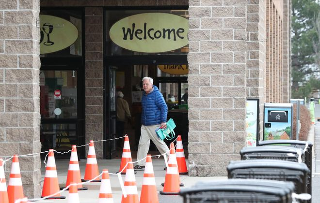 Roped off areas keep customers from each other at the Wegmans on Military Road in Niagara Falls on Tuesday, March 31, 2020. (James P. McCoy/Buffalo News)