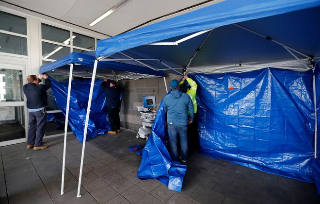 Crews set-up a medical triage tent outside of Mercy Hospital in South Buffalo on March 27.(Mark Mulville/News file photo)