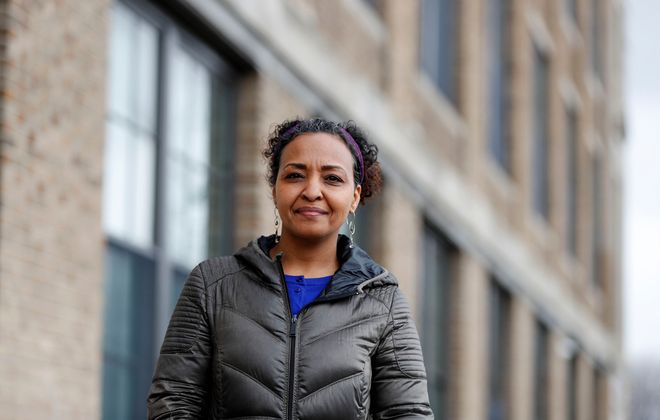 Rahwa Grimatzion, executive director of PUSH Buffalo outside of the offices on Buffalo's West Side. (Mark Mulville/News file photo)