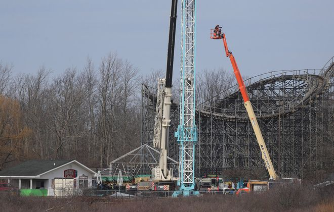A crane works on a ride at Fantasy Island on Wednesday, March 11, 2020. (John Hickey/Buffalo News)
