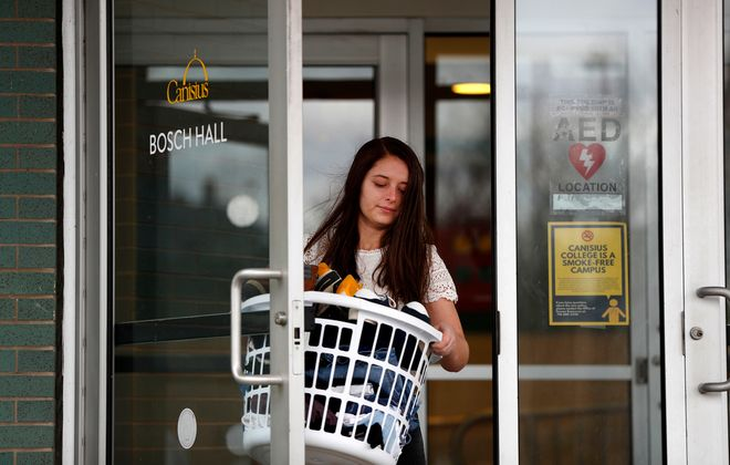 Canisius College student Izzy Rennoldson moves her belongings out of her dorm room last week. (Mark Mulville/Buffalo News)