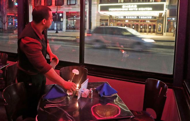 With restaurants closed except for takeout, governments need to look for creative ways to support workers in both the hospitality and gig industries. (Robert Kirkham/Buffalo News)