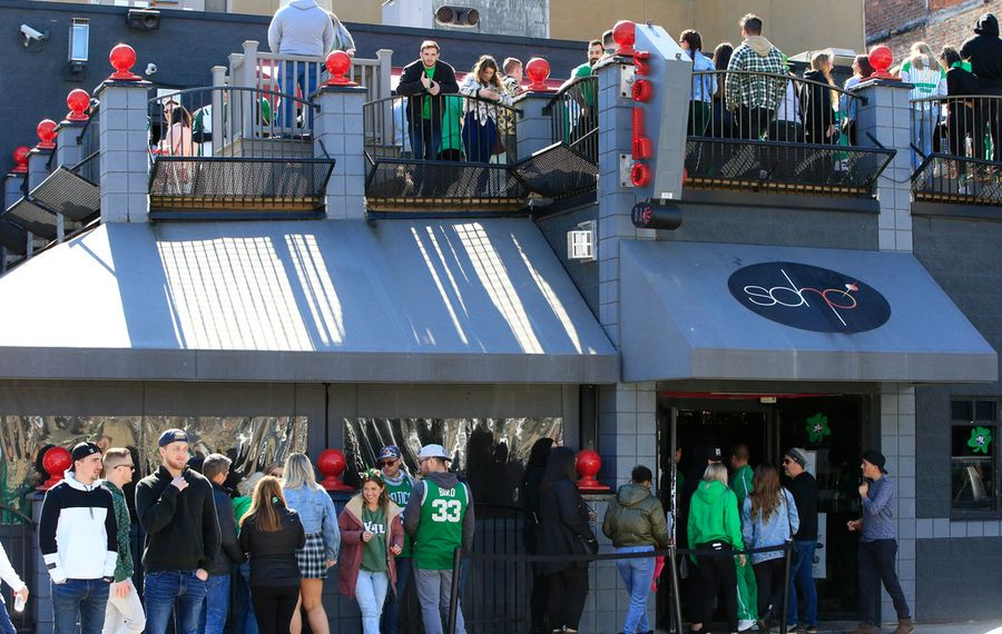 Revelers gathered at a Chippewa Street bar after last month's St Patrick's Day Parade was cancelled. Too many people, especially younger ones, are still ignoring the urgent public health need to maintain social distance. (Harry Scull Jr./Buffalo News)