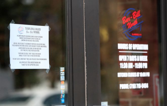 A sign on the door of Bar-Bill North for its customers after the COVD-19 outbreak. (Harry Scull Jr./Buffalo News file photo)