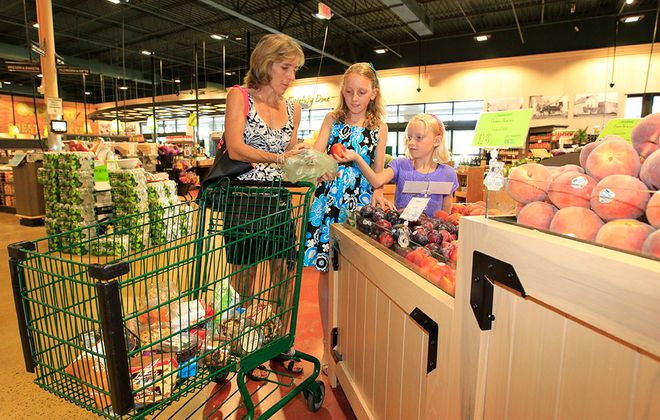 Carol DeNysschen shops with her children at Orchard Fresh in Orchard Park in 2014. (Harry Scull Jr/News file photo)