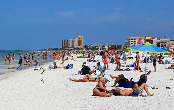 People gather on Clearwater Beach in Florida during spring break last week despite world health officials' warnings to avoid large groups. (Getty Images)