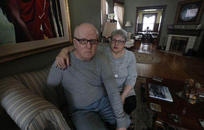 John Howell and his wife Maria Arza saw the tax bill on their Buffalo home rise by 150% after the recent reassessment. Howell has cancer and is concerned about how his wife will pay the higher bill after he dies. (Sharon Cantillon/Buffalo News)