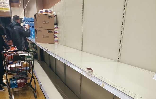 Empty shelves in the toilet paper section at Wegmans on Transit Road in Depew on Sunday, March 8, 2020. (Sara Meehan/Buffalo News)