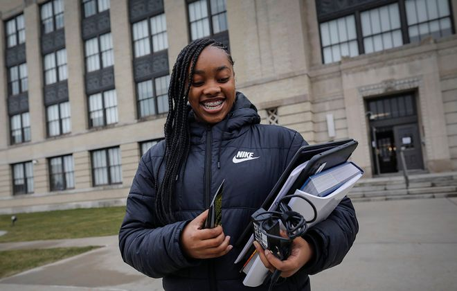 Tenth grade student Kaleah Phillips, 15, carries her school supplies after picking up her work at  Kensington Frederick Law Olmsted School 156. (Derek Gee/Buffalo News)