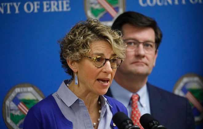 Erie County Health Commissioner Dr. Gale Burstein speaks during a press conference to update the public on the COVID-19 coronavirus as County Executive Mark Poloncarz looks on, Tuesday, March 17, 2020. (Derek Gee/Buffalo News)