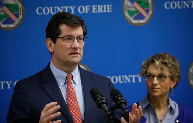 Erie County Executive Mark Poloncarz updates the public on COVID-19 as Health Commissioner Dr. Gale Burstein listens. (Derek Gee/News file photo)