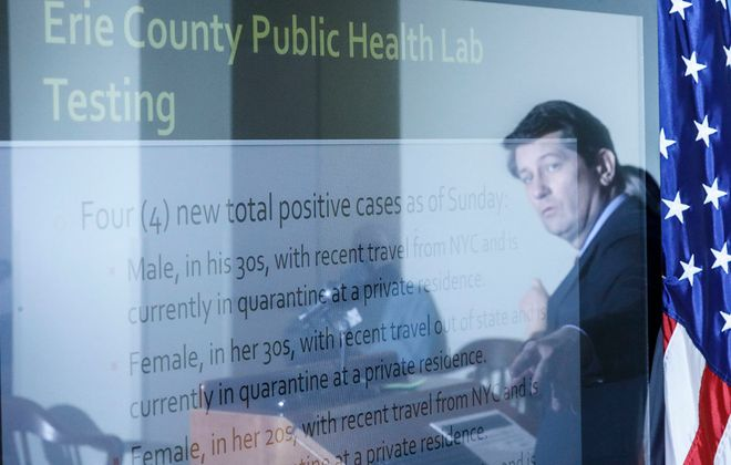 Erie County Executive Mark Poloncarz is reflected in a television monitor as he speaks at a news conference March 16, 2020. (Derek Gee/Buffalo News)