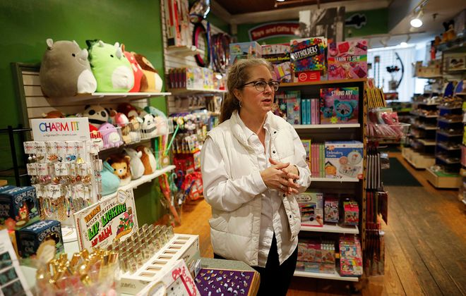 """TreeHouse Toys owner Gaetana Schueckler is keeping the store open but offering curbside delivery as well as """"concierge"""" service with help selecting toys over the phone and through FaceTime in addition to their website, (Derek Gee/Buffalo News)"""