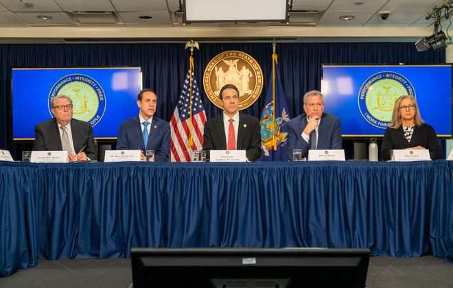 Gov. Andrew Cuomo, center; New York City Mayor Bill de Blasio, second from right; state Department of Health Commissioner Howard Zucker, second from left; Kenneth Raske, left, president and CEO of the Greater New York Hospital Association; and Bea Grause, right, president of the Healthcare Association of New York state hold a news conference Monday on the first confirmed case of COVID-19 in New York. (Getty Images)