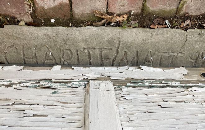 "Despite at least two succeeding owners and 20 years of intense renovations, ""Charlie/Matt 94"" remained in a piece of cement in the childhood home of writer Charles Roberts. (Photo courtesy Charles Roberts)"