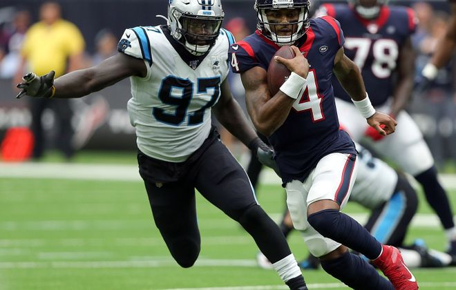 Carolina's Mario Addison chases down Houston QB Deshaun Watson during a game in September 2019. (Getty Images)