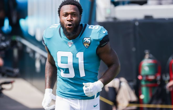 Yannick Ngakoue of the Jacksonville Jaguars is seeking a new team, but the Jaguars plan to use the franchise tag on him (Harry Aaron/Getty Images)