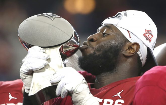 Oklahoma's Neville Gallimore kisses the trophy after the Sooners defeated the Baylor Bears in the Big 12 Championship game in Dallas on Dec. 7, 2019. (Ron Jenkins/Getty Images)