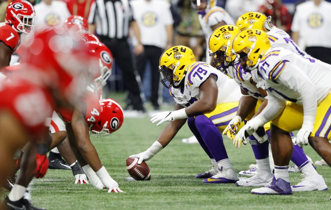 Lloyd Cushenberry III (79) of the LSU Tigers prepares to snap the ball in the first half against the Georgia Bulldogs during the SEC Championship game at Mercedes-Benz Stadium in Atlanta. (Kevin C. Cox/Getty Images)