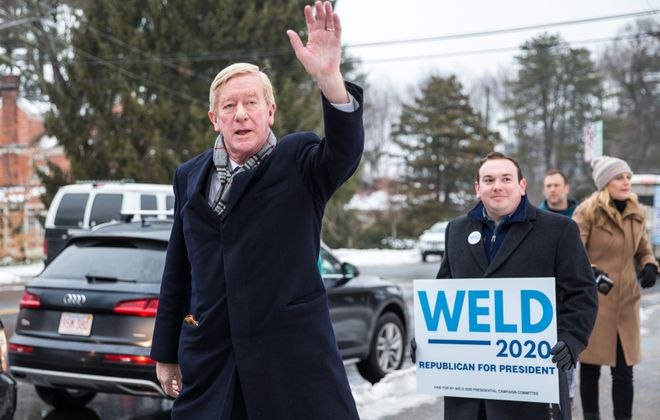 Republican presidential candidate former Massachusetts Governor Bill Weld waves to voters at the Webster Elementary School during the presidential primary on Feb. 11 in Manchester, N.H.  (Photo by Scott Eisen/Getty Images)