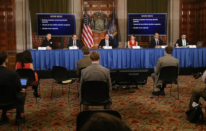 One of the governor's daily news conferences. (Getty Images)