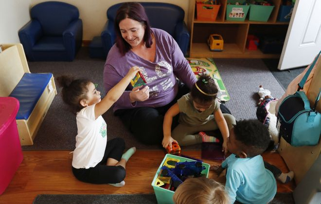 As businesses prepare to reopen in New York, some parents will face a dilemma: With schools closed, who will watch their children if they return to work. Here, Jellybeans Child Care owner Danielle Kinsman takes care of children in her Town of Tonawanda business. (Sharon Cantillon/News file photo)