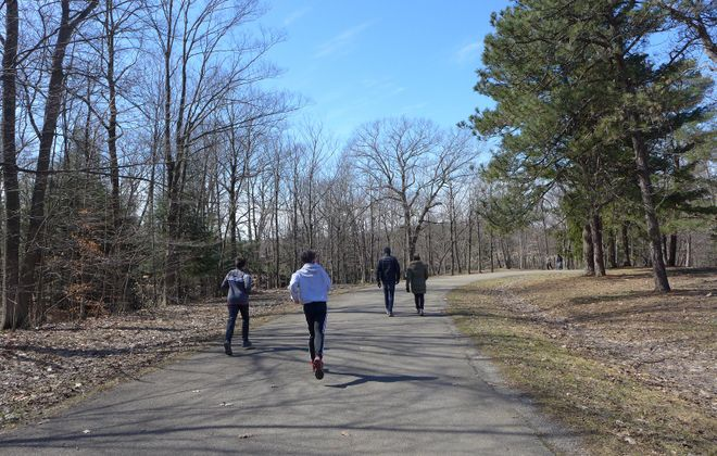 At Chestnut Ridge Park in Orchard Park, walkers and runners keep their distance while taking advantage of the great outdoor space. (Photo by Nancy Parisi/Special to The News)