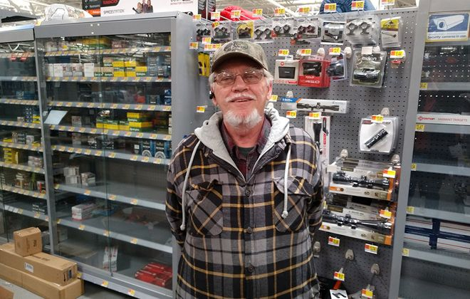 Ken Sanger went shopping at Walmart in Cheektowaga for extra ammunition for his .16-gauge shotgun on Monday, March 16, 2020, because he fears the COVID-19 outbreak might cause people to act unpredictably. He is standing next to nearly empty shelves of ammunition. (Lou Michel/Buffalo News)