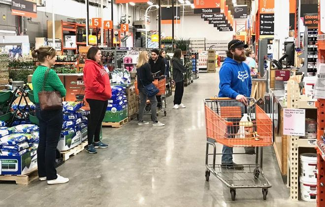 Workers at a local Home Depot saw a rush to buy paint supplies on March 20. (Robert Kirkham/Buffalo News)
